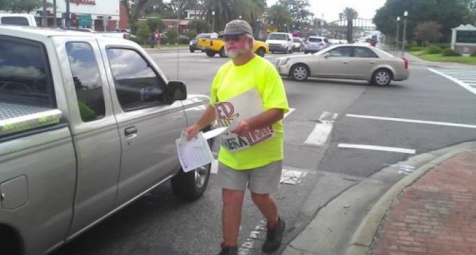 Man arrested for peacefully protesting red light cameras