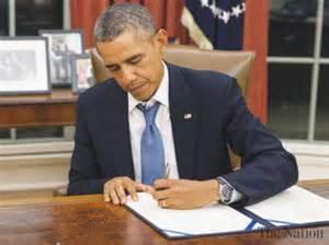 obama signing signs