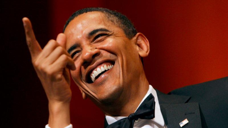 obama smiling pointing