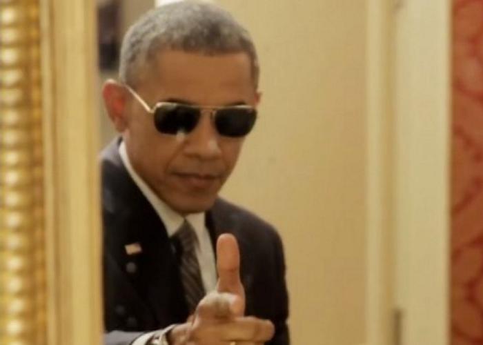 obama shades finger gun