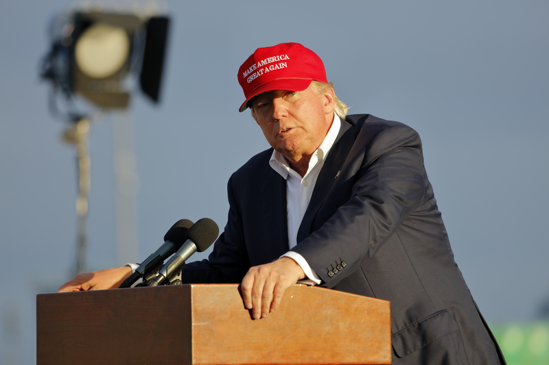 donald trump red hat looking