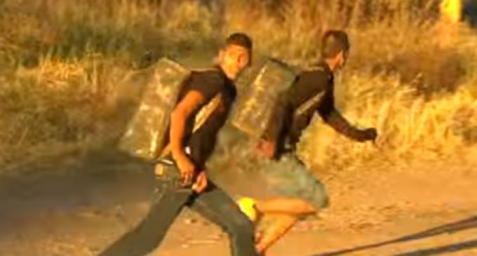 Mexican Drug Smugglers Filmed Climbing Border Fence