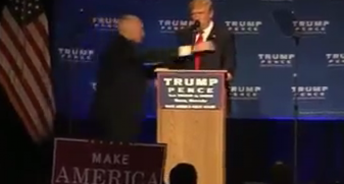 Trump Rushed Away After Protester 'With a Gun' Tried to Storm Stage