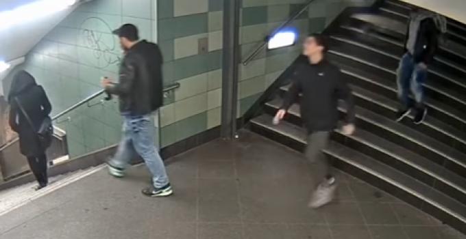 migrants_kick_woman_stairs