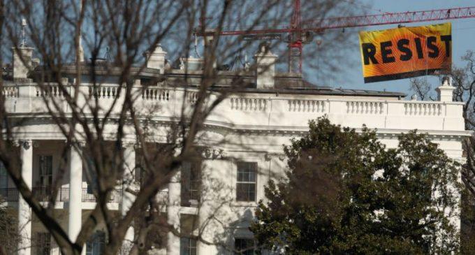Greenpeace Activists Climb Crane, Hang 'Resist' Sign Near White House