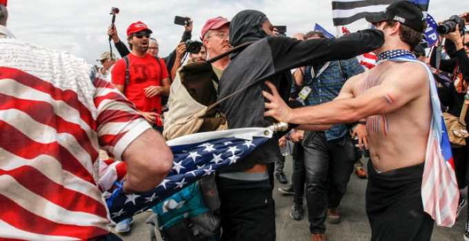 Supporters of President Donald Trump scuffle with counter-protesters during a rally on Saturday, March 25, 2017, in Huntington Beach, Calif. (Irfan Khan/Los Angeles Times via AP)