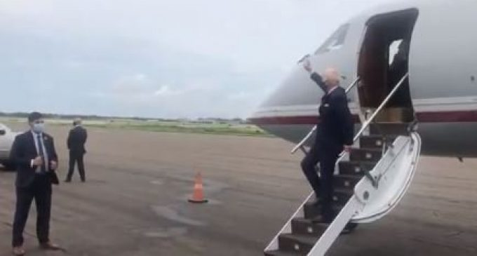 Joe Biden Waves at Empty Field as He Departs Plane in Tampa