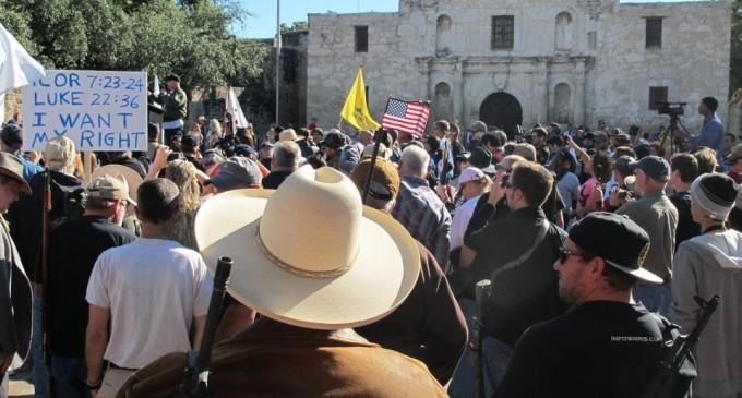 Armed gun rights activists rally at the Alamo